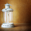 Old white lantern with a mysterious light on the background of t — Stock Photo #52841545