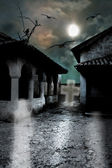 Scary dark courtyard in the ominous moonlight night in a cold Ha — Stock Photo