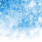Mooie sneeuwvlokken op abstracte achtergrond met bokeh effect — Stockfoto