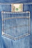 A hundred dollar bills sticking in the back pocket of denim blue — Stock Photo