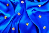 Beautiful silk wavy fabric blue with gold stars — Stock Photo