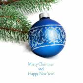 Blue Christmas ball and green spruce branch isolated on white ba — Stock Photo