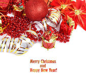 Red Christmas ball with gifts, beads and ornaments isolated on w — Stock Photo