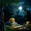 Halloween pumpkins in yard of old house night in bright moonligh — Stock Photo #53562243