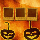 Festive pumpkin Halloween Day with  slides on the abstract paper — Stock Photo