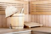 Traditional wooden sauna for relaxation with bucket of water  — Foto de Stock