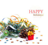 Christmas tree branch with gift in red box on white background i — Stock fotografie