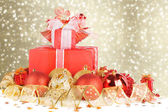 Christmas gifts and balls with gold ribbon on a beautiful abstra — Stock Photo