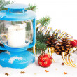 Snowy blue lantern and Christmas balls on the background of fir  — Stock Photo #57902275