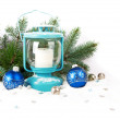 Snowy blue lantern and Christmas balls on the background of fir — Stock Photo #58222145