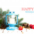 Snowy blue lantern and Christmas balls on the background of fir — Stock Photo #58222297