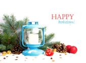 Snowy blue lantern and Christmas balls on the background of fir — Stock Photo