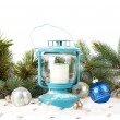 Snowy blue lantern and Christmas balls on the background of fir — Stock Photo #58504317