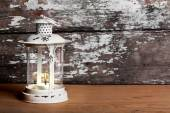 Old Christmas lantern on background of  old brick wall and floor — Stok fotoğraf