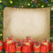 Christmas greeting card with presents on the green abstract bac — Stock Photo #59688089