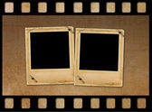 Old paper slides for photos on rusty abstract background  — Stock Photo