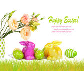 Easter eggs, bunnies and fun bouquet of flowers isolated on whit — Stock Photo