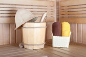 Traditional wooden sauna for relaxation with bucket of water and — Stock Photo