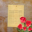 Old vintage card with a beautiful red rose on paper background — Stock Photo #65359451