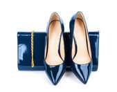 Beautiful blue shoes with clutches on white isolated background — Stock Photo