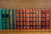 Richly decorated volumes of books with a gold lettering on the b — Stock Photo