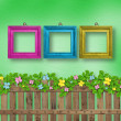 Wooden fence with a flower garland on the abstract background of — Stock Photo #67755787