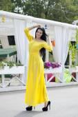 Beautiful young woman in yellow dress — Stock Photo
