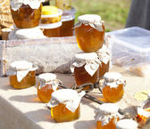 Exhibition sale of natural honey — Stock Photo