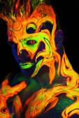 Body art glowing in ultraviolet light — Stock Photo