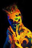 Body art glowing in ultraviolet light  — Stock Photo