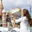 Young beautiful girl holding a tourist map of Moscow — Stock Photo #52144511