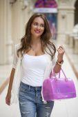 Beautiful young woman walks in the shop  — Stock Photo