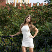 Beautiful young woman in white sexy dress — 图库照片