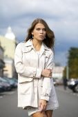 Young beautiful woman in white coat — Stock Photo