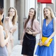 Four beautiful fashion women walking on the street  — Stock Photo #52657379