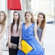 Four beautiful fashion women walking on the street  — Stock Photo #52657383