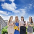 Four beautiful fashion women walking on the street  — Stock Photo #52657463