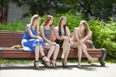 Four Teenage Girls Sitting On Bench In summer Park  — Stock Photo