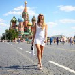 Young women walking in white dress at the red square in Moscow — Stock Photo #52664475