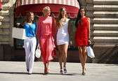 Four shopping women walking at the red square in Moscow — Stock Photo