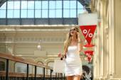 Portrait of a beautiful young lady out shopping — Stock Photo