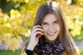 Happy beautiful woman calling by phone  — Stockfoto
