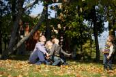 Russian family, young parents and two sons — Stock Photo