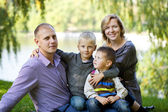 Russian family, young parents and two sons — Stockfoto