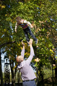 Little boy and father in autumn park — Stock Photo