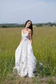 Beautiful young woman in white sexy dress — Stock Photo