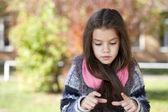 Beautifal little girl in the autumn park  — Stock Photo