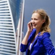 Beautiful young blonde calling by phone — Stock Photo #54307095