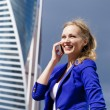 Beautiful young blonde calling by phone — Stock Photo #54301775