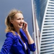 Beautiful young blonde calling by phone — Stock Photo #54307101